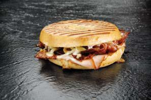 smoked provolone cheese, dried tomatoes, crispy bacon, sliced turkey, mayonnaise, bread.