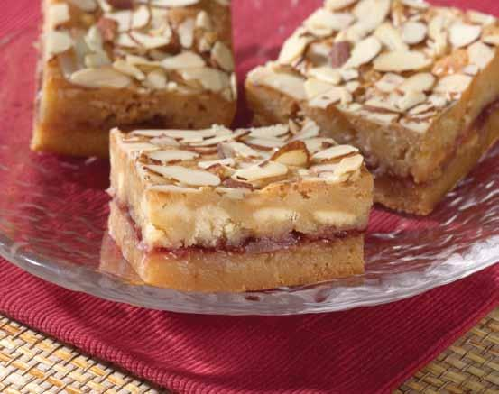 teaspoon almond extract 1 cup all-purpose flour 2/3 cup cherry preserves 1/2 cup flaked coconut 1/2 cup sliced almonds MELT butter in a small saucepan over low heat, stirring just until melted.