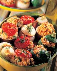 Put the stuffing inside the vegetables and place them in a greased baking tin. Drizzle with olive oil, replace the tops on each vegetable.