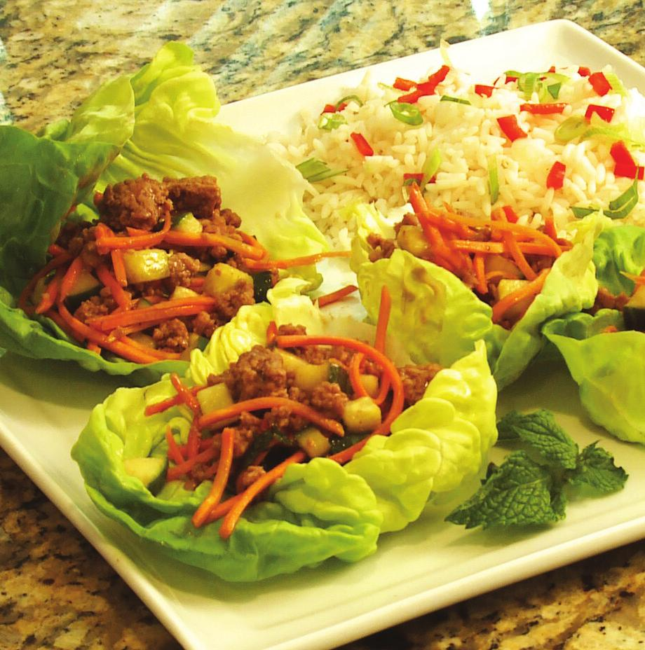 Asian Lettuce Wraps makes 6 servings 1-1/2 pounds ground veal 3/4 cup peanut sauce 2 cups chopped seeded cucumber 1/2 cup shredded carrot 1/4 cup torn fresh mint 12 large Boston lettuce leaves (about