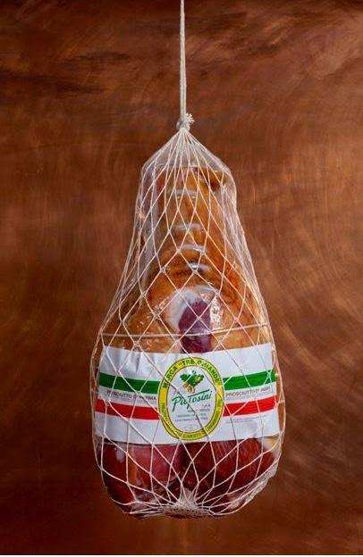 This delectible prosciutto, sweet to the palate, is cured in the town of Langhirano, Italy, and bears the honorable mark of the Consorzio del Prosciutto di Parma.