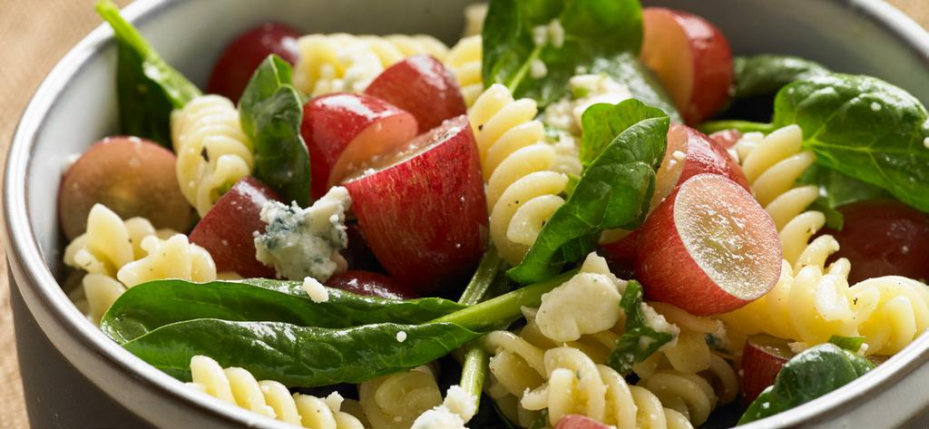 Pasta with Grapes, Blue Cheese and Spinach Makes 6 servings Perfect for a potluck, picnic or party, this salad is anything but ordinary.