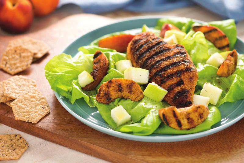 Blackened Chicken with Grilled Peaches 1 cup Crunchmater Multi-Seed Rosemary & Olive Oil Crackers, ground 4 fresh peaches, sliced 1 large apple, chopped 1 head Bibb lettuce, torn 4 skinless chicken