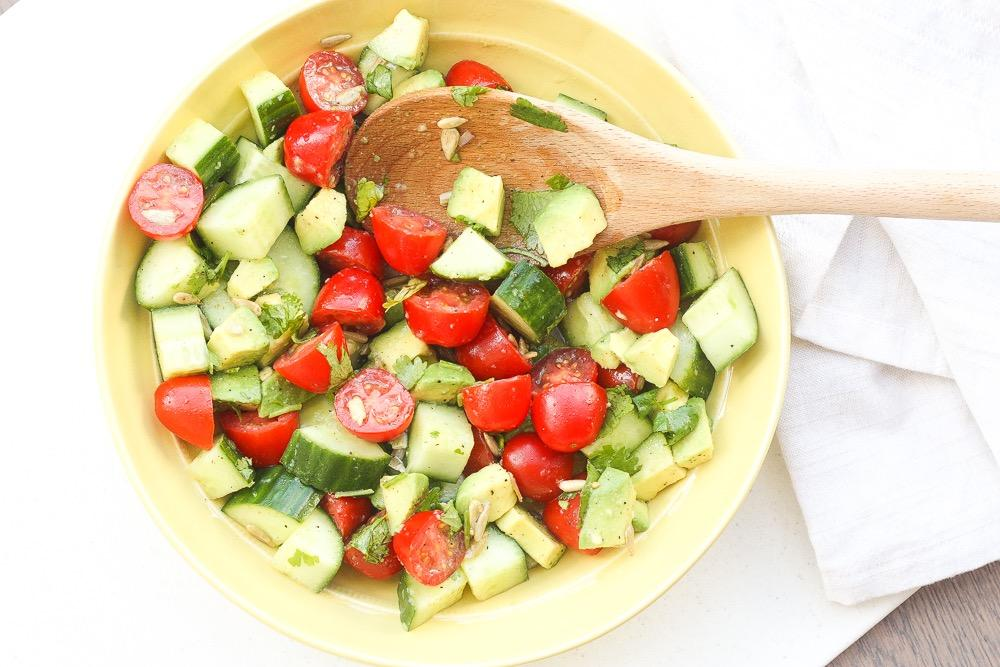 SIMPLE TOMATO CUCUMBER AND AVOCADO SALAD 1 cup grape tomatoes, halved 1/2 English cucumber, sliced and quartered 1 avocado, chopped 1/4 cup cilantro, chopped 1 tablespoon sunflower seeds 3