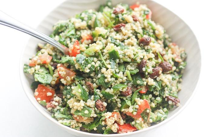 QUINOA SPINACH POWER SALAD WITH LEMON VINAIGRETTE 1/2 cup uncooked quinoa 2 cups spinach, finely chopped 1 tomato, diced 1/2 cup diced cucumbers 1/4 cup raisins 1 and 1/2 tbsp.