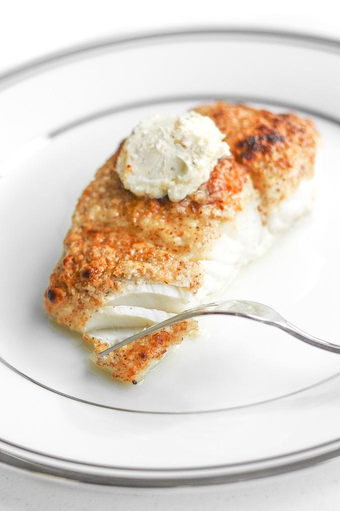 ALMOND-CRUSTED HALIBUT WITH LEMON GARLIC BUTTER Lemon Garlic Butter: 1/2 tbsp. garlic, minced 1/2 tbsp. fresh lemon juice 1/2 tsp. lemon zest 1/8 tsp. salt 1/8 tsp.