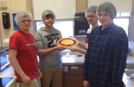 Wilson Jr High School Page 2 of 2 Brett, Alexis, Austin and Chris proudly display the fruit pizza they crafted on a bed of marscapone cheese.