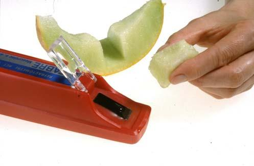 prepared fruit are placed onto the refractometer prism plate.