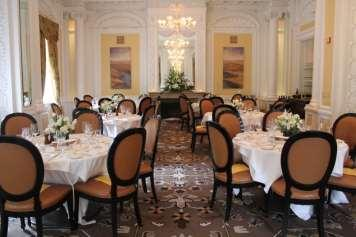 The largest dining room, The Valentine, overlooks Franklin Street and the hotel s main entrance.