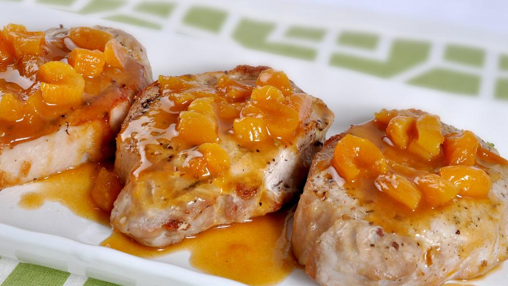 APRICOT GLAZED PORK CHOPS MAKES 4 SERVINGS 4 (4 oz) boneless pork loin chops 1/2 cup coarsely chopped dried apricots 1/3 cup orange juice 1/4 cup apricot nectar 2 tsp honey 1 (2-inch) piece lemon
