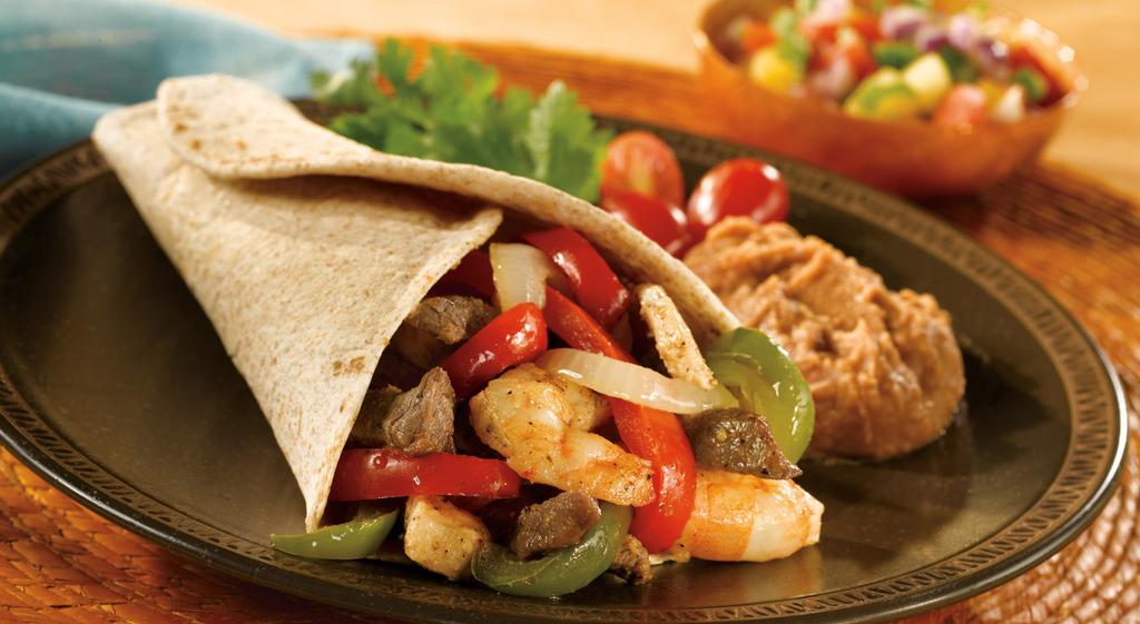 FAJITAS MAKES 2 SERVINGS 1 tbsp fajita seasoning mix 1 tbsp salad oil 1 tbsp water 1/2 lb mixture of raw, peeled and deveined shrimp, chicken breast strips and beef strips.