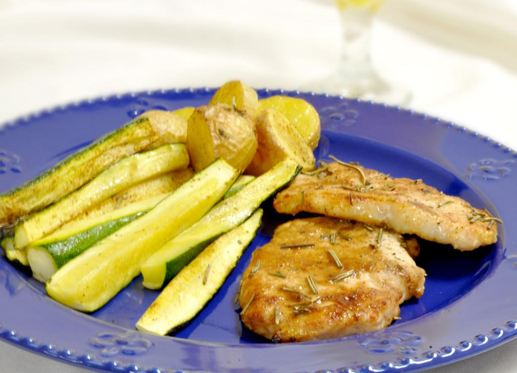 PORK MAKES 2 SERVINGS 2 boneless pork chops, approximately 12 oz 1/2 lb zucchini strips, approximately 1/2 x 1/2 x 2-1/2 inches 1-1/3 cups new potatoes, cut into 1/2-inch wedges 1 tsp olive oil 1.