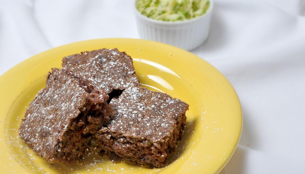 CHOCOLATE CHIP ZUCCHINI CAKE MAKES 9 SERVINGS 1/2 cup butter or margarine, softened 1 cup sugar 1 cup white whole wheat flour 2 tbsp unsweetened cocoa 1/2 tsp baking soda 1/4 tsp baking powder 1/4