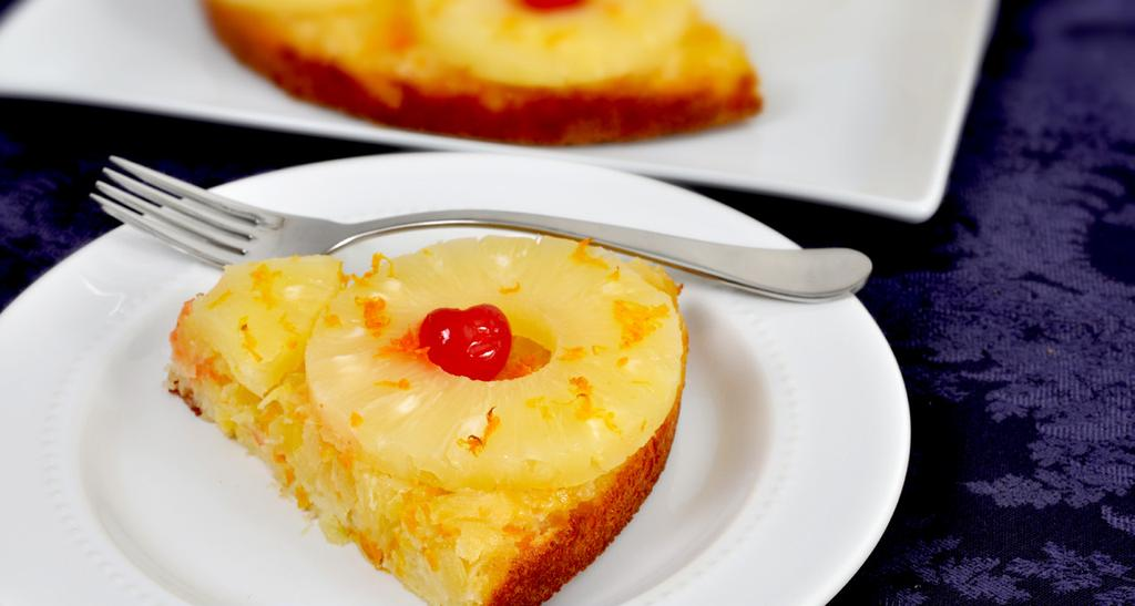 PINEAPPLE-ORANGE UPSIDE DOWN CAKE MAKES 8 SERVINGS 1 can (8-1/4 oz) crushed pineapple in juice, drained (reserve juice) 1/4 cup shredded orange peel 2 eggs 1 egg white 3/4 cup sugar 1 tsp vanilla 3/4