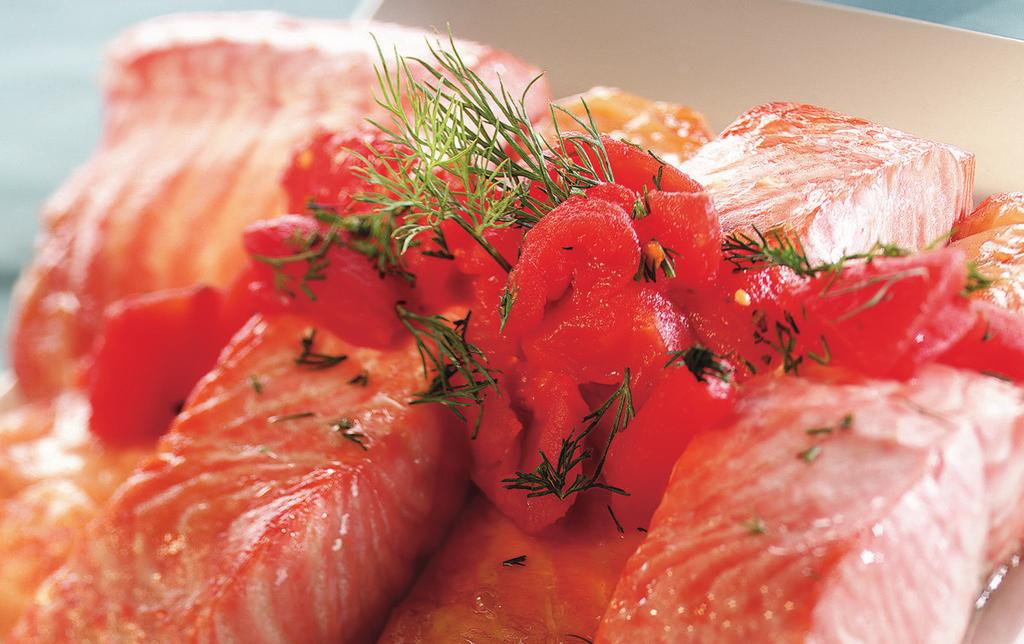 SALMON WITH DILLED TOMATOES MAKES 4 SERVINGS 1 (14 oz) can Italian-style diced tomatoes 1/4 cup finely chopped fresh dill weed 1 tsp minced garlic 4 (6 oz) salmon fillets, 1 inch thick 1.