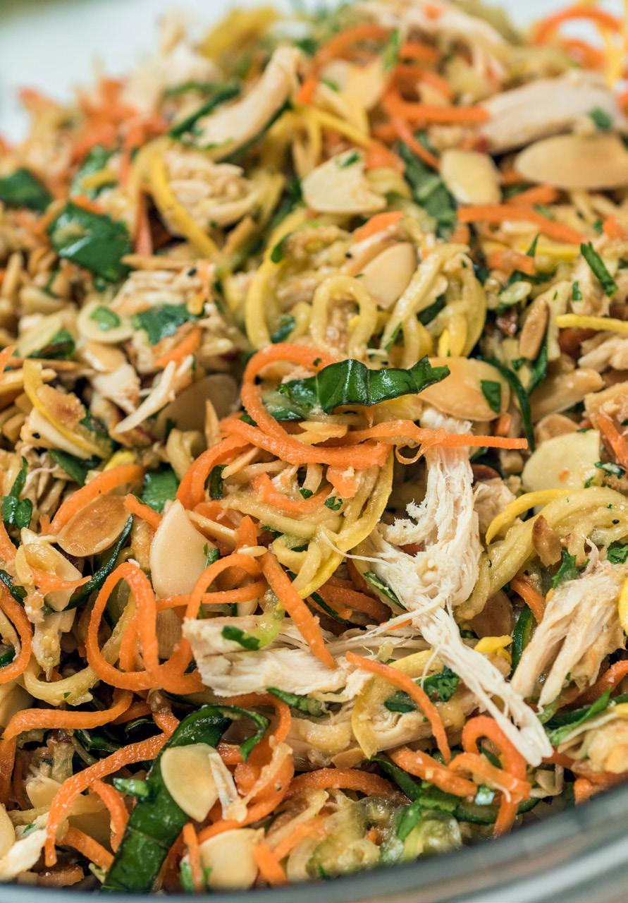 Thai Vegetable & Chicken Salad Serves: 4 1 large English cucumber 1 large yellow squash 1 large, thick carrot, peeled 3 cups cooked shredded chicken 1 cup toasted sliced almonds 1/2 cup fresh