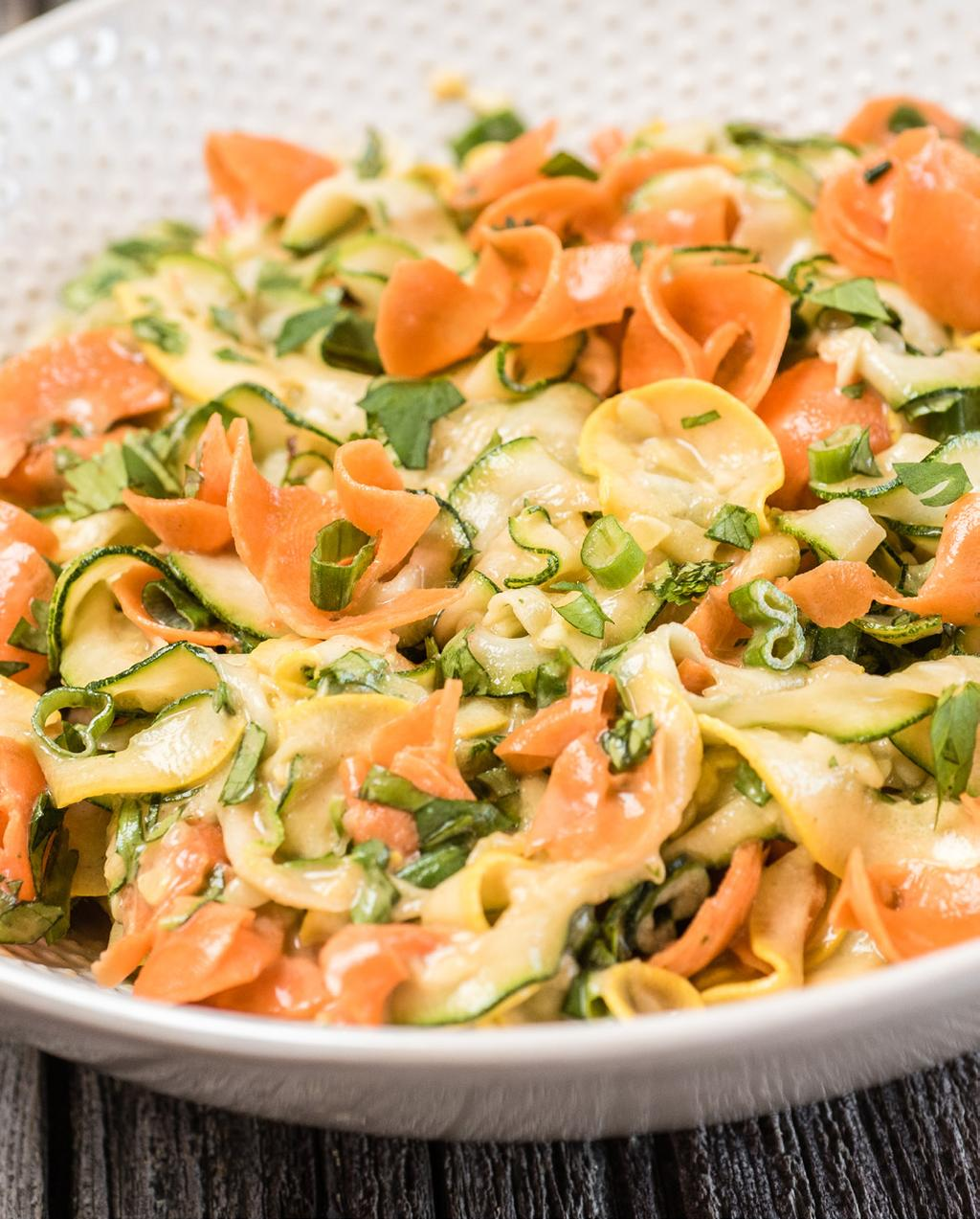 Veggie Ribbon Salad with Peanut Sauce Serves: 6 1/3 cup creamy peanut butter 2 tablespoons rice wine vinegar 1 tablespoon plus 1 teaspoon honey 1 tablespoon soy sauce 1 teaspoon lime juice 1 teaspoon