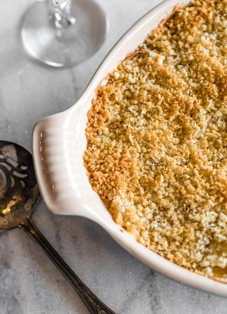 Cheesy Au Gratin Potatoes Serves: 4-6 1 small onion, chopped 1 clove garlic, minced 5 tablespoons butter, divided 2 large russet potatoes 1 tablespoon all-purpose flour 1/2 teaspoon ground mustard