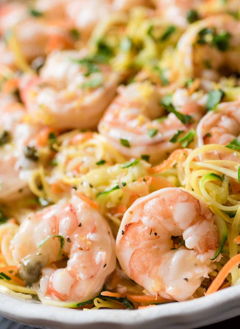 Lemon Garlic Shrimp & Veggie Pasta Serves: 4-6 2 large zucchini 2 large yellow squash 2 large, thick carrots, peeled 3/4 cup butter 4 cloves garlic, minced 1 tablespoon cornstarch 1/2 cup chicken
