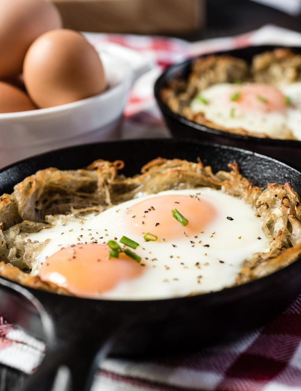 Potato and Egg Nests Serves: 1-2 1 large (10 ounces) russet potato 2 tablespoons finely chopped onion 1 tablespoon vegetable oil 1/4 teaspoon salt 1/4 teaspoon ground black pepper 2 large eggs