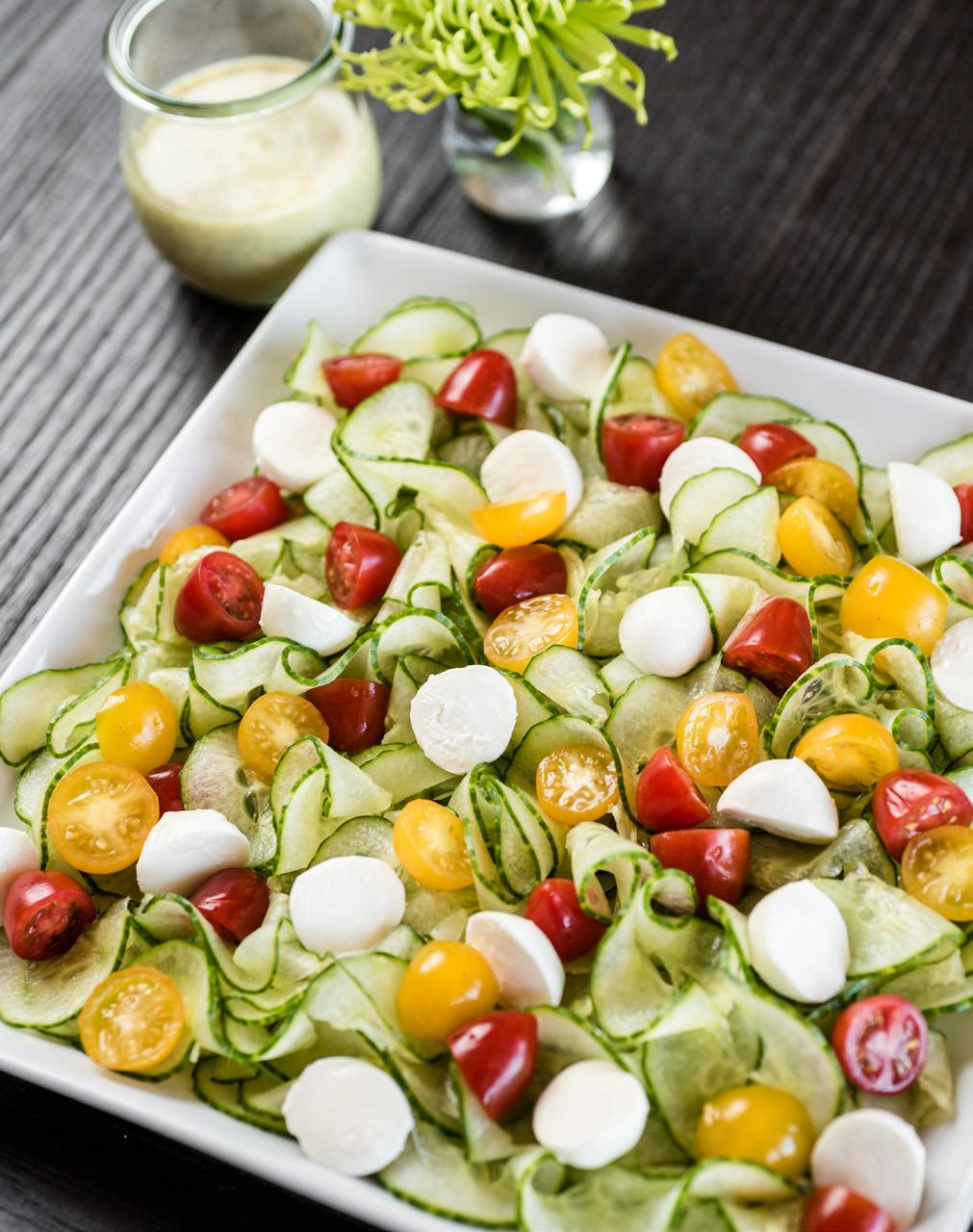 Cucumber Caprese Salad Serves: 8 2 medium seedless cucumbers 1 cup red cherry tomato halves 1 cup yellow cherry tomato halves 1 cup fresh mozzarella balls, halved Salt and coarse black pepper 1/3 cup