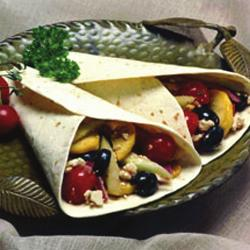 Greek Wrap 4 10-inch wheat or whole wheat tortillas ¾ cup crumbled feta cheese 16 cherry and/or yellow pear tomatoes, halved 10 extra-large black olives, drained, halved ½ medium red onion, thinly