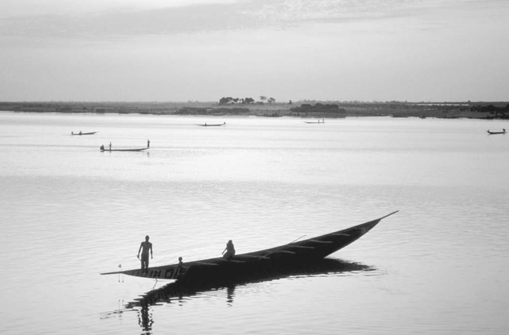 178 Niger River A boat crosses the Niger River at the present-day town of Mo