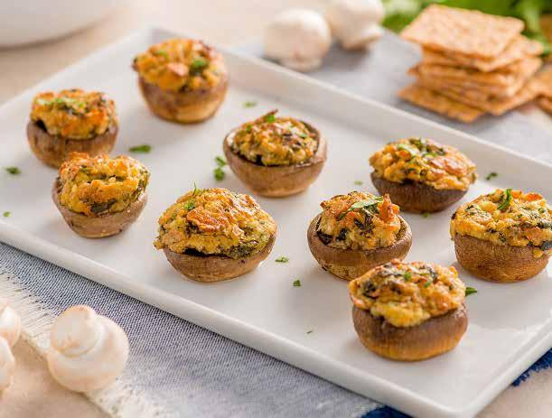 White Cheddar Stuffed Mushrooms ½ cup Crunchmaster Multi-Grain White Cheddar Crackers, crushed ¼ cup grated Pecorino Romano cheese 2 oz.