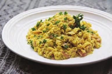 When the ham is crispy and sweet potatoes are soft, add cumin and stir. Add the eggs, season with salt and pepper and scramble until eggs are cooked through. Serve topped with the parsley.