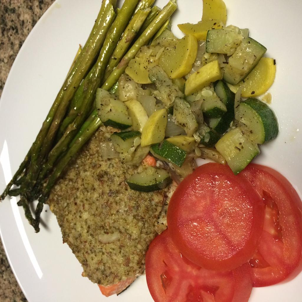Basil Almond Crusted Salmon with Roasted Asparagus, Sautéd Zucchini and Squash 4 4oz Salmon Filets 1/2 cup almonds 2 small garlic cloves Fresh Basil Leaves (about 20) 5 Tbsp coconut oil 1 lemon,