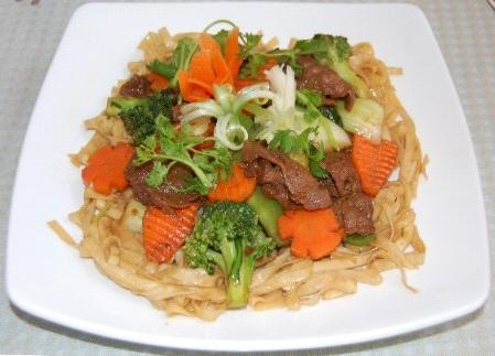 Soft-Noodles - Mì xào mềm A pan fried soft egg noodle containing mixed vegetables (carrot, broccoli, mushroom, baby bokchoy, baby corn, and