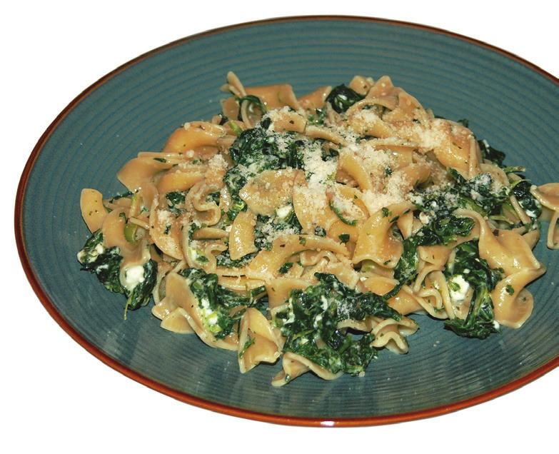 CHEESE SPINACH NOODLES Makes 6 servings Prep Time: 20 minutes Cook Time: 15 minutes 8 ounces whole-wheat egg noodles 10 ounce package frozen chopped spinach, thawed and drained 1/2 teaspoon dried
