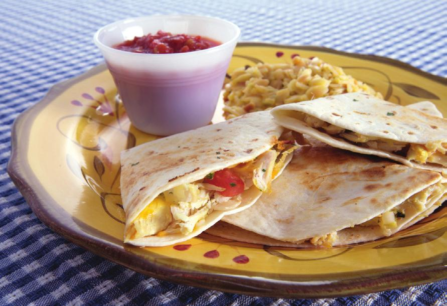 CHICKEN QUESADILLAS Makes 4 servings Serving Size: 1 quesadilla 1 cup chopped, cooked chicken 2 tablespoons salsa 1/4 cup chopped white onion Non-stick vegetable cooking spray 1/4 cup canned chopped