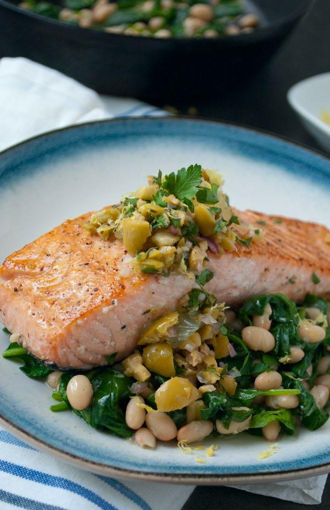 Seared Salmon & Olives Seared salmon is paired with mellow white beans and garlicky spinach in this quick, healthy recipe. Top it with a flavorful olive relish.