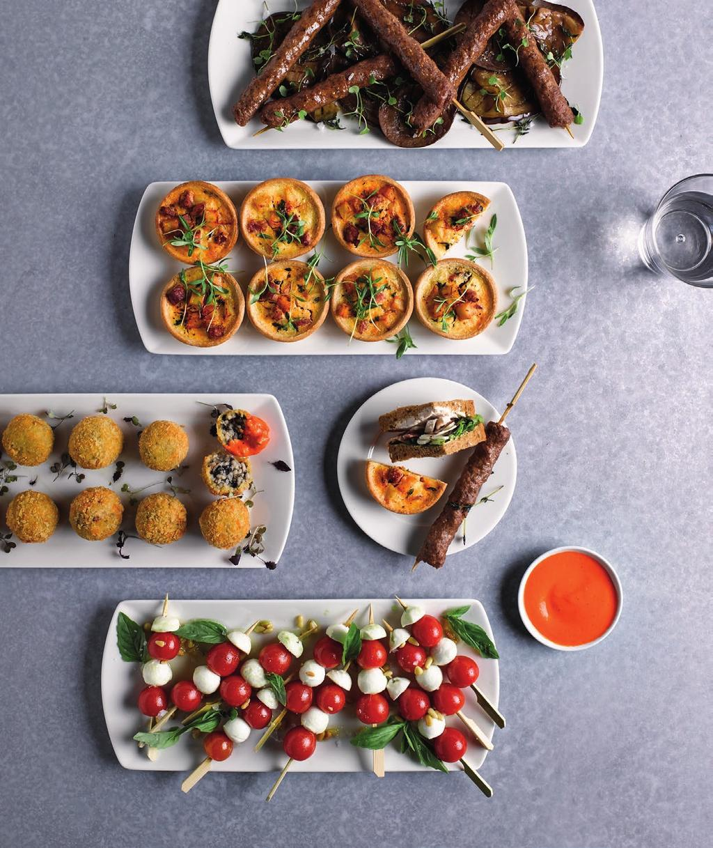 FINGER FOOD PREMIUM SANDWICH PLATTERS SERVED ALONGSIDE YOUR CHOICE OF TWO HOT AND TWO COLD DISHES FOR GUESTS TO HELP THEMSELVES; PERFECT FOR INFORMAL LUNCHES.