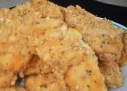 Breaded Chicken 6 skinless, boneless chicken breasts 2 cups sour cream 2 cups crushed cornflakes cereal Garlic salt 1 tsp Italian-style seasoning 6 tbs