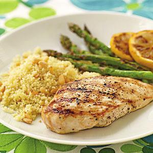 Lemon-Grilled Chicken Breasts Serves 7 1. 3 tablespoons fresh lemon juice 2. 2 tablespoons extra virgin olive oil 3. 2 garlic cloves, minced 4. 7 6-ounce skinless, boneless chicken breast halves 5.