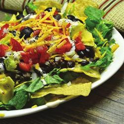 Touchdown Taco Salad Serves 8 1. ½ pound lean ground Beef 2. 1 ½ cups (6 ounces) shredded Cheddar cheese, divided 3. ½ cup Salsa, divided 4. 8 cups Salad greens 5. 1 cup chopped Tomato 6.