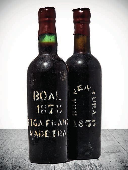 217 218 Henriques & Henriques, WS Boal Both lot levels: into neck; new metal capsules, badly bin soiled labels, bottled 1927, rebottled 1957 2 bottles per lot $2,800-3,800 1 bottle per lot