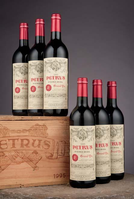CHATEAU PETRUS Château Pétrus 1990 One top shoulder, two very high shoulder level; two labels torn, one slightly damp stained...sweetness, low acidity, and velvety tannins.