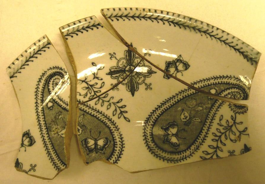 conjoining, from a minimum of two saucers and one cup, decorated with grey transfer prints in a pattern