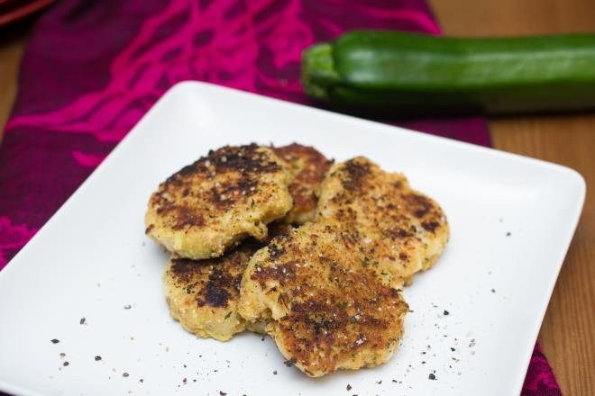Zucchini Patties 2 cups grated zucchini 2 eggs, beaten 1/4 cup chopped onion 1/2 cup all-purpose flour 2 cloves garlic, minced 1/2 cup grated