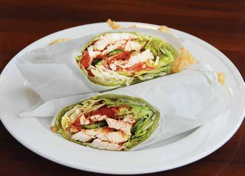 95 A Spinach Tortilla filled with Lite Tuna Fish and topped with Tomatoes, Cucumbers and Mixed Field Greens Vegetarian Wrap... $9.