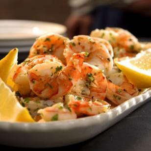 Per serving: 73 calories Total time: 10 Minutes Lemon Garlic Shrimp Starter Place garlic and oil in a small skillet and cook over medium heat until fragrant, about 1 minute.