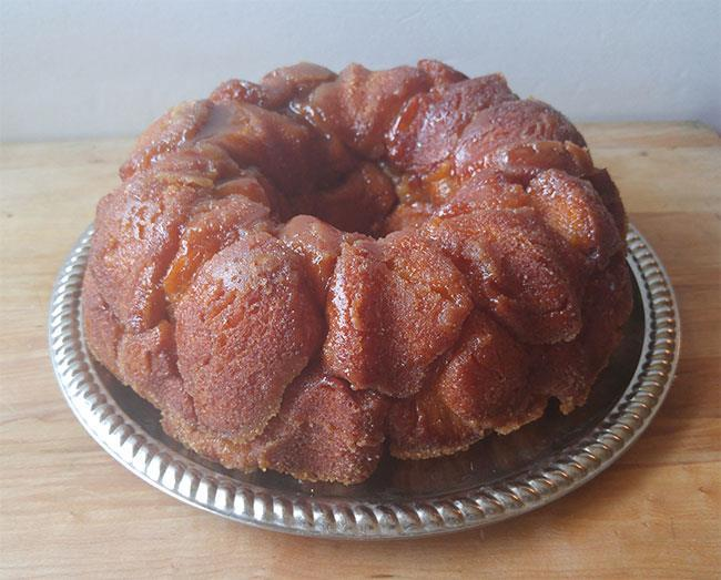 Easy Monkey Bread 1/2 cup granulated sugar 1 cup firmly packed brown sugar 1 teaspoon cinnamon 2 cans Pillsbury Grands biscuits (8 pack) 3/4 cup butter or margarine melted 1.