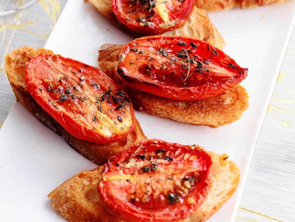 Crostini with Thyme Roasted Tomatoes 4 plum tomatoes, halved lengthwise Extra virgin olive oil 1 to 2 teaspoons dried thyme 8 1/2 inch thick slices baguette 1 clove garlic 1.