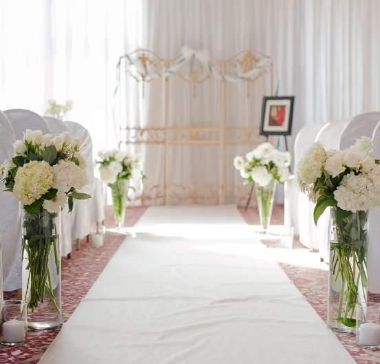 white curtain with LEDs behind the table of honour, Diva white couch, projector and projection screen Chair bands (red, black or apple green) Silver