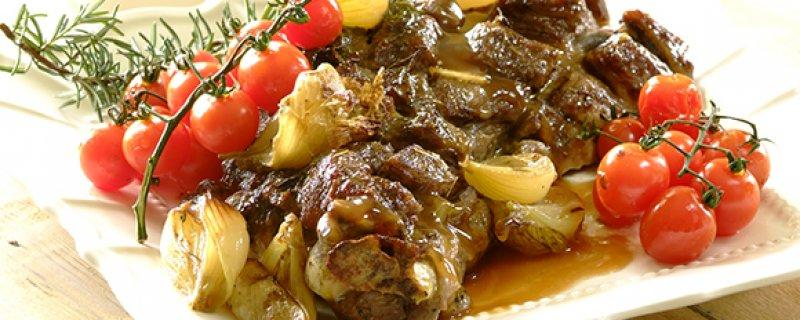 Roast shoulder of lamb with garlic and tomatoes Sunday 10th September COOK TIME 02:00:00 PREP TIME 00:20:00 A delicious shoulder of lamb with baby onions, garlic, cherry tomatoes and fresh herbs!
