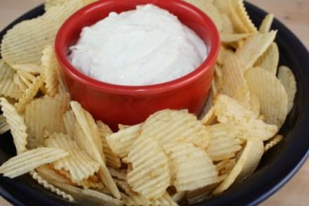 Onion Dip 1-2 tablespoons of oil 1 onion, chopped 2 cloves garlic, minced 1/2 cup water 1 cup sour cream 8 ounce of cream cheese 2-3 tablespoons mayonnaise ½ teaspoon salt ( or more to taste) ½
