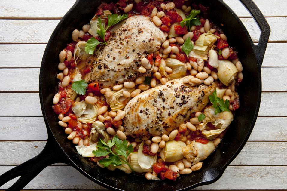 Chicken Skillet Bake Yield: Serves 4 Time: 30 min. 1 1/2 lb. chicken breasts, cut into four servings 2 Tbsp. olive oil 1 15-oz. can diced tomatoes 2 15-oz. cans white beans 1 15-oz.